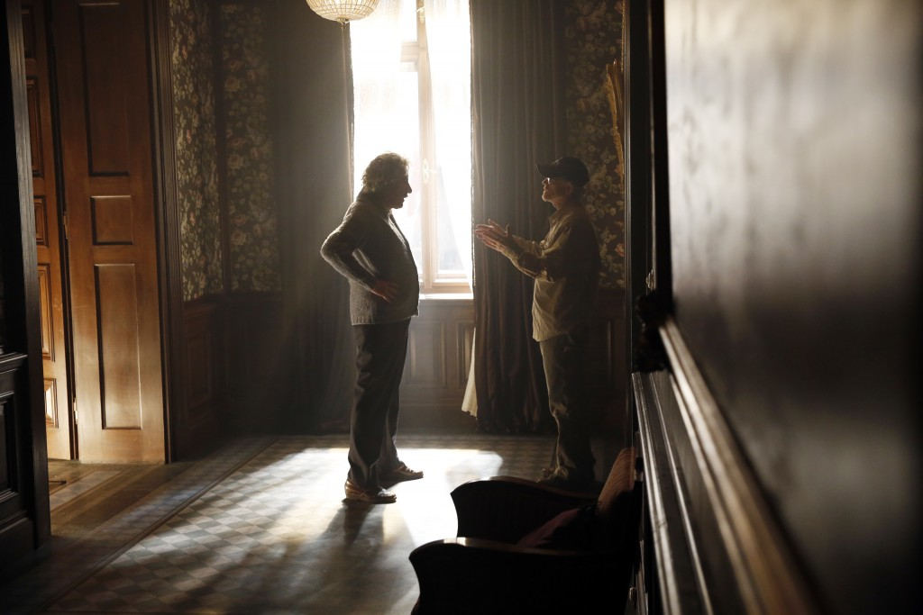 Czech Republic - Geoffrey Rush (Albert Einstein) and director Ron Howard discuss a scene on the set of National Geographic's Genius (National Geographic/Dusan Martincek)